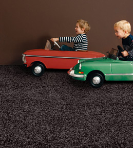 Children driving on durable Garage Carpet
