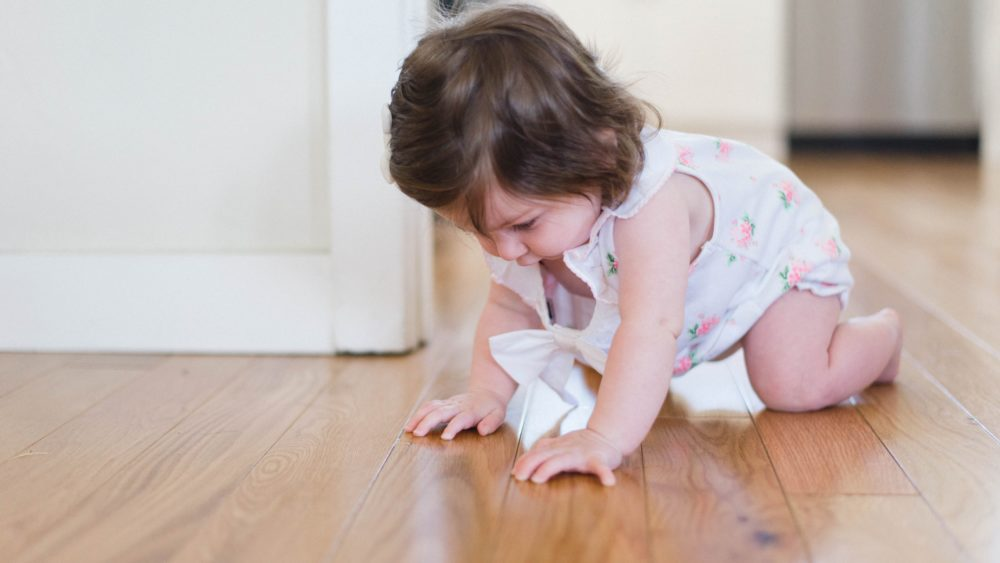 Toddler crawling on timber floor